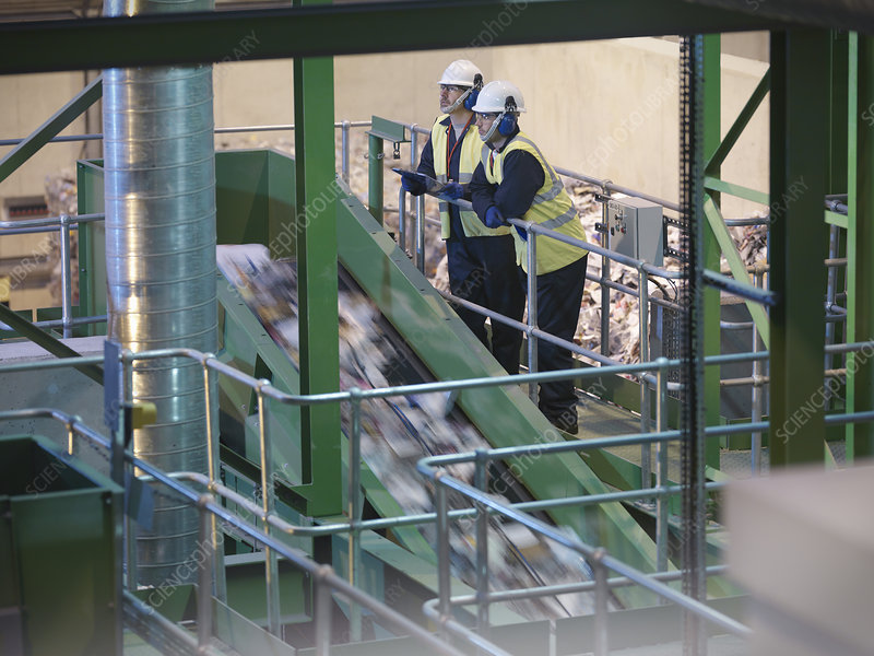 Workers Overlooking Recycle Plant