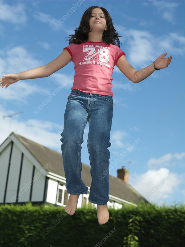 Girl, 10 on trampoline