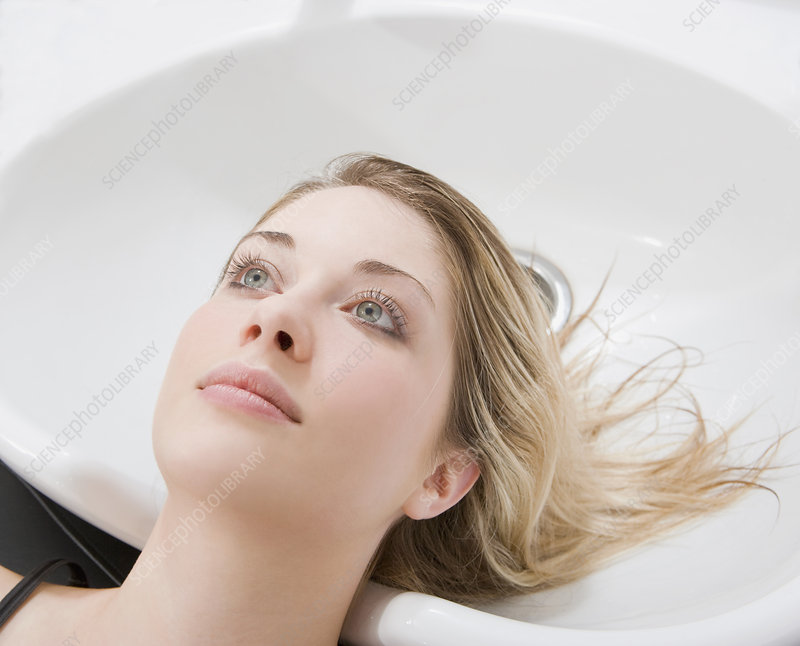 woman at sink at hairdressers