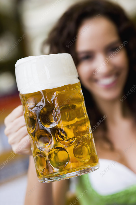 Young Woman With Glass Of Beer