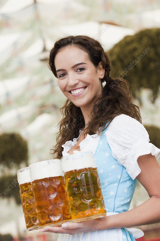 Young Woman Serving Beer