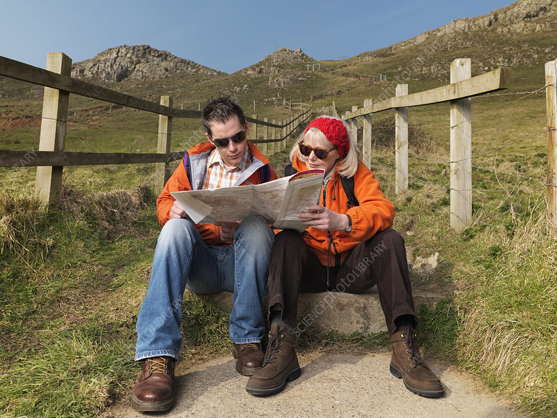 man & woman studying map