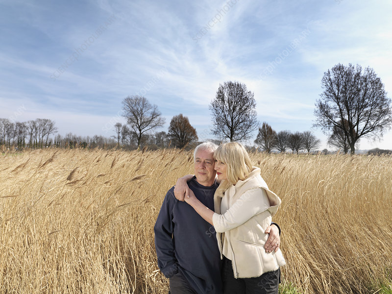 mature couple standing in field