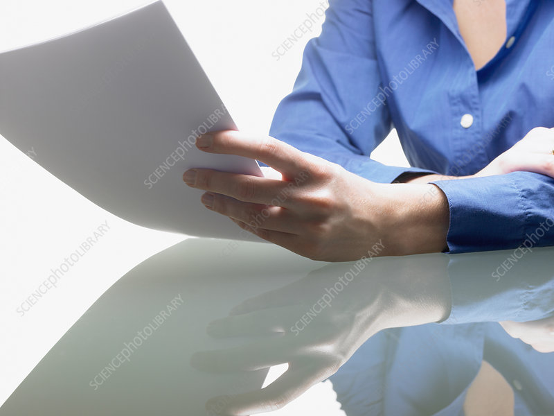 Hands of a woman, holding a file