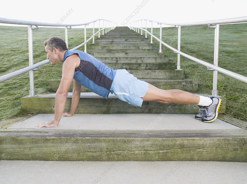 Man Stretching on Steps