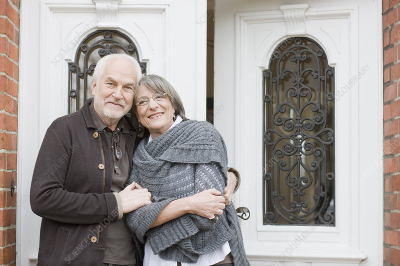 old couple standing at front door
