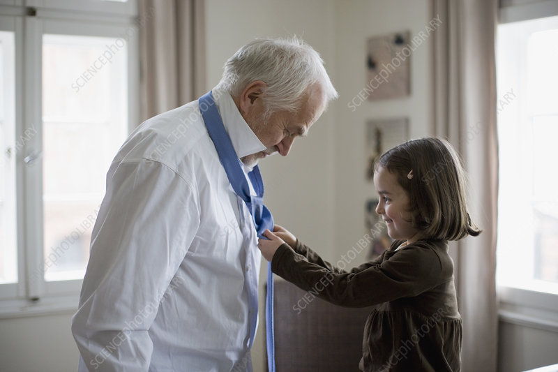 granddaughter helping grandfather