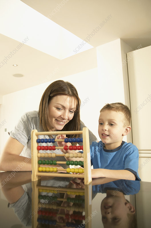 mum and son with abacus