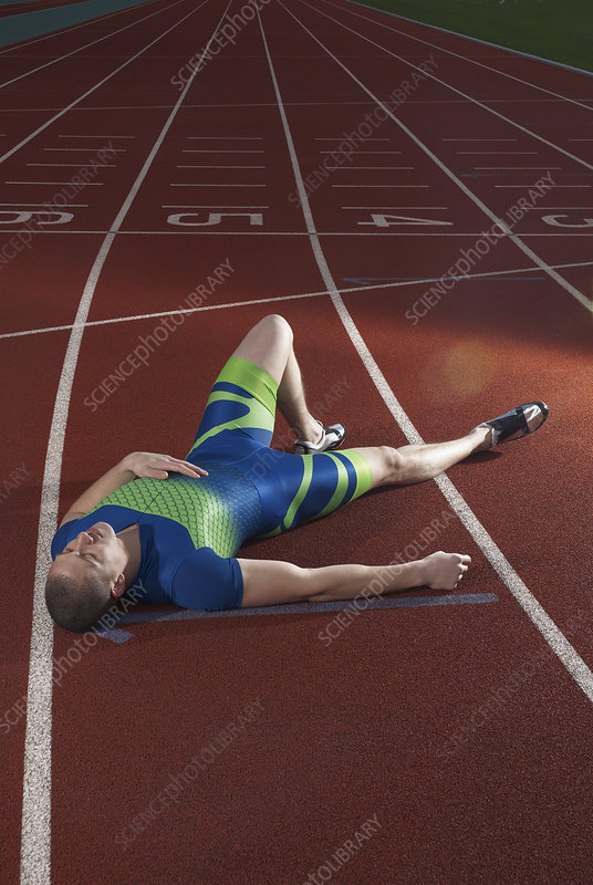 athlete lying on track