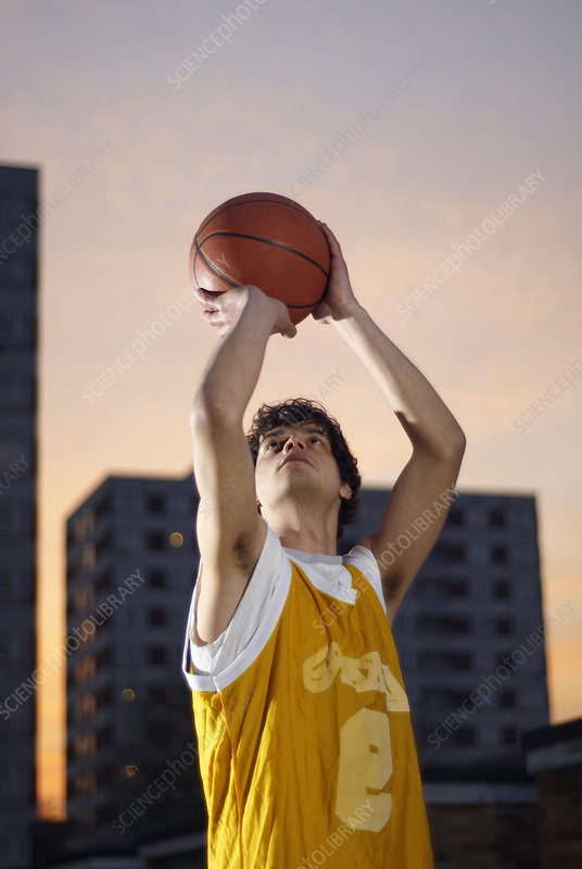 basketball player taking shot