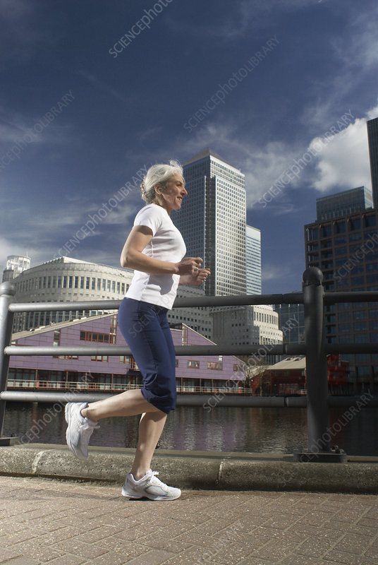 woman running by city