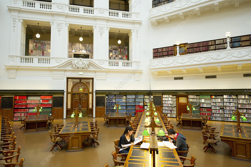 Students studying in empty library