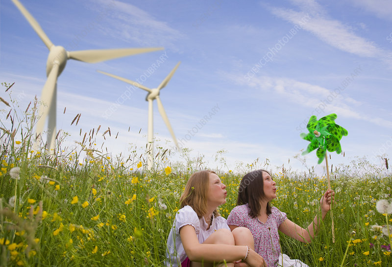Teenage girls with wind turbines