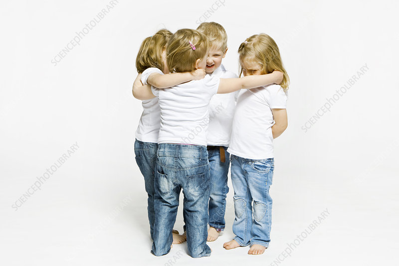 Four toddlers hugging