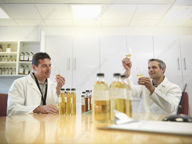 Scientists tasting whisky in plant
