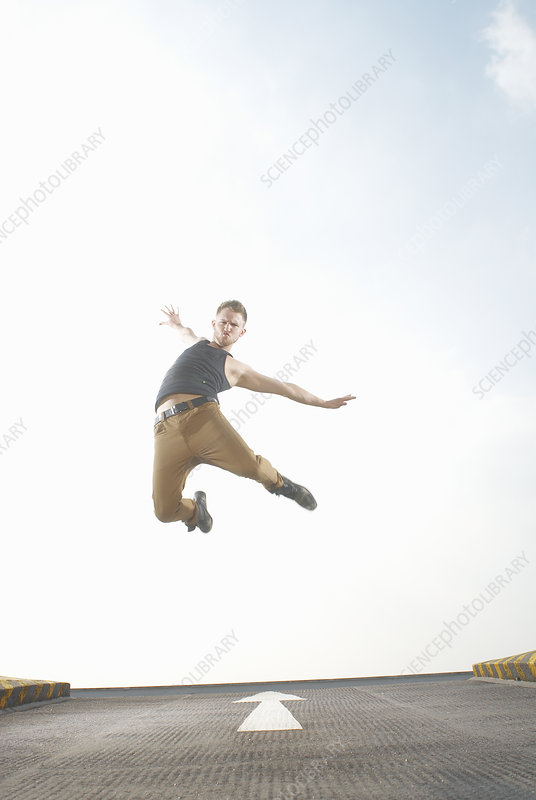 Man jumping in road