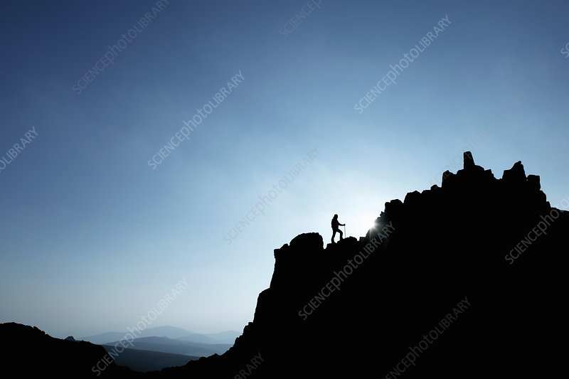 Man hiking on rocky hillside