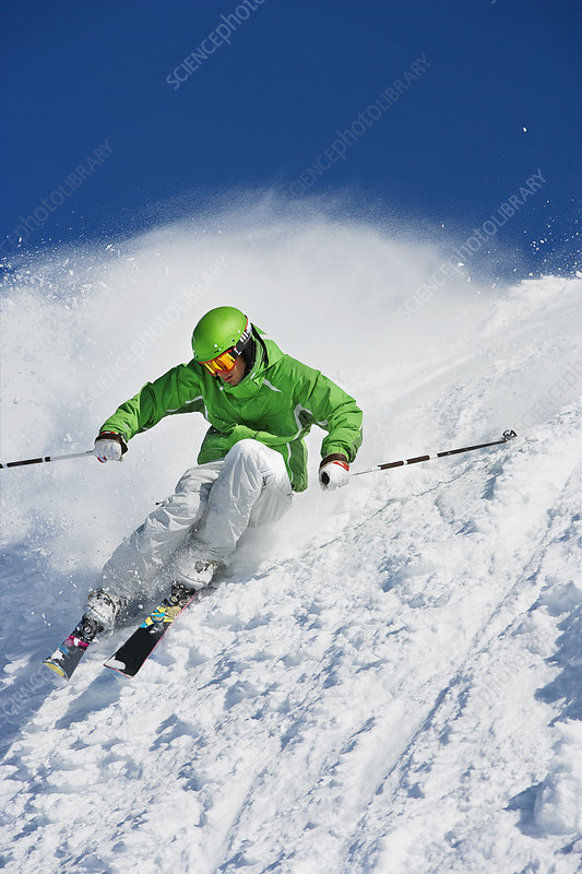 Man in green carving off piste