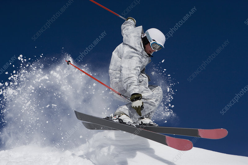 Man in white & grey camo suit off-piste