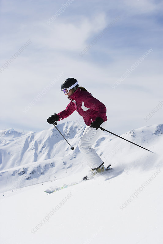 Woman in red & white outfit off-piste