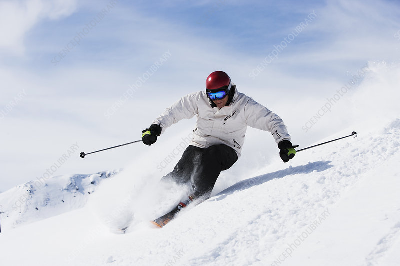 Man in white with red helmet off-piste