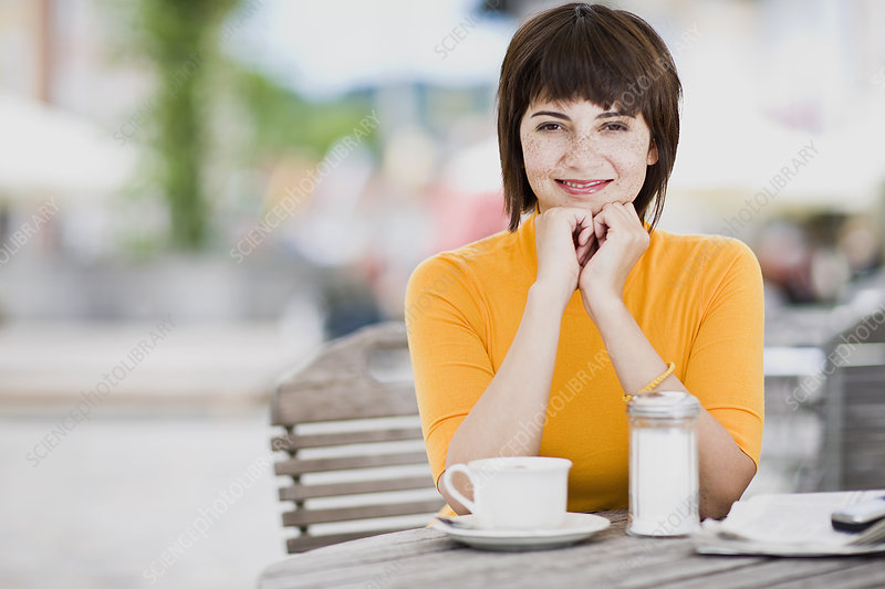 woman waiting in a street cafe