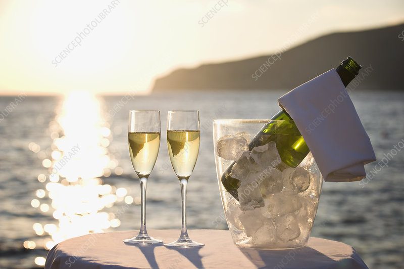 Two glasses of champagne at sunset