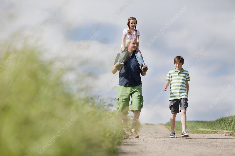 family of three walking down the road