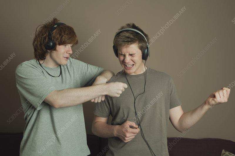 Boys playing air guitars