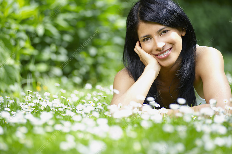Woman in the daisies, smiling