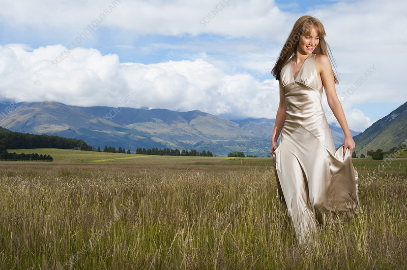 Woman in Silk Dress Walking in Field