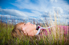 Woman Lying in Grass Relaxing