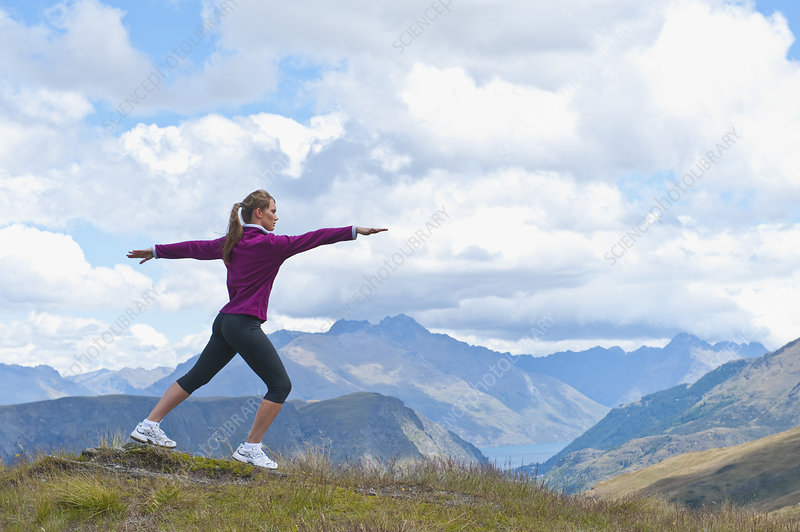 Woman Exercising on Mountain Top