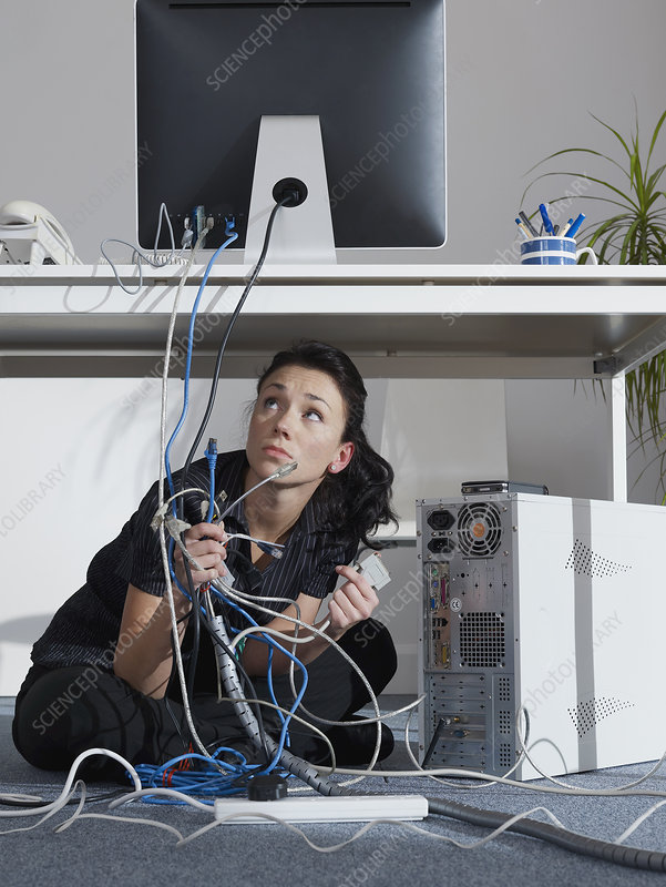 An office girl tries to fix her computer