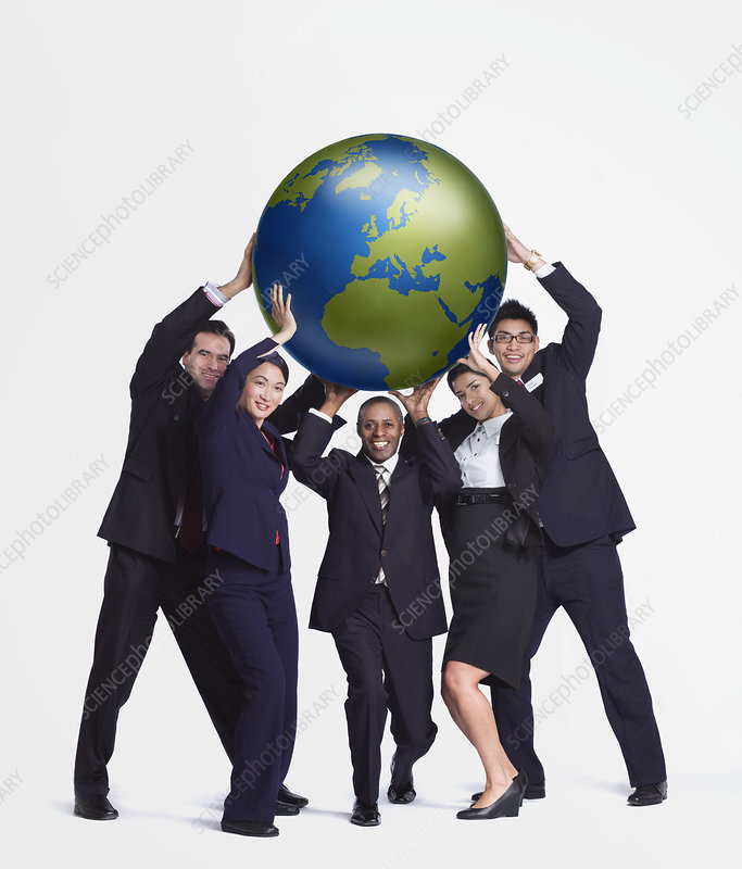 A business group holding up a big globe