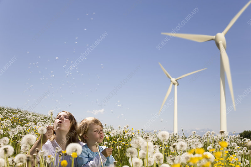 Girl and boy at wind turbine