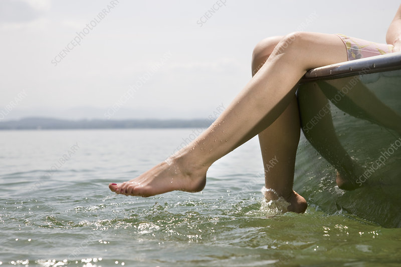 woman sitting on boat on lake