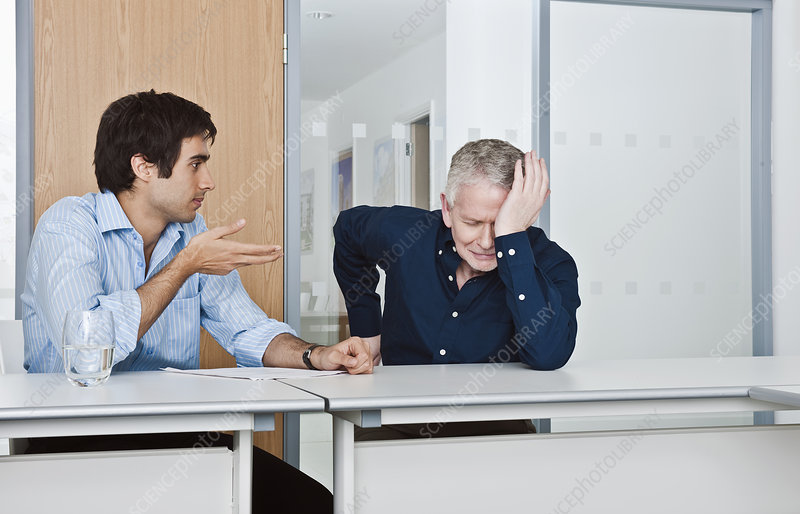 man consoling work colleague