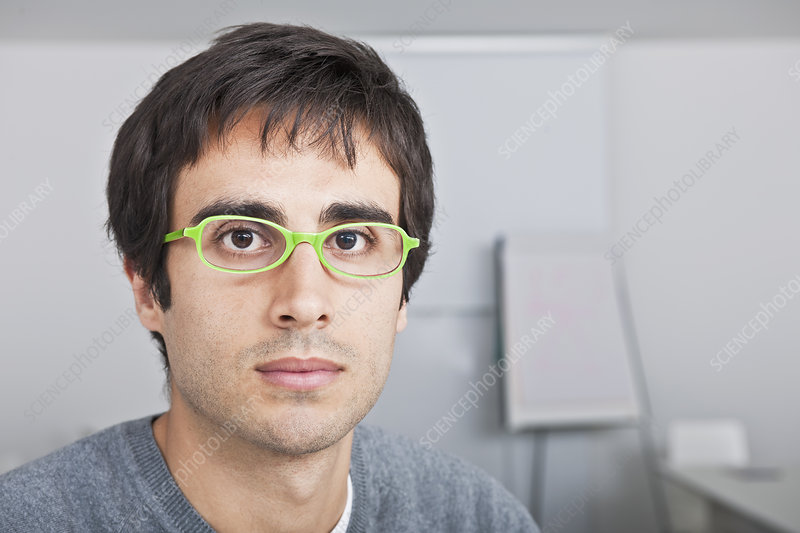 portrait of young man with green glasses