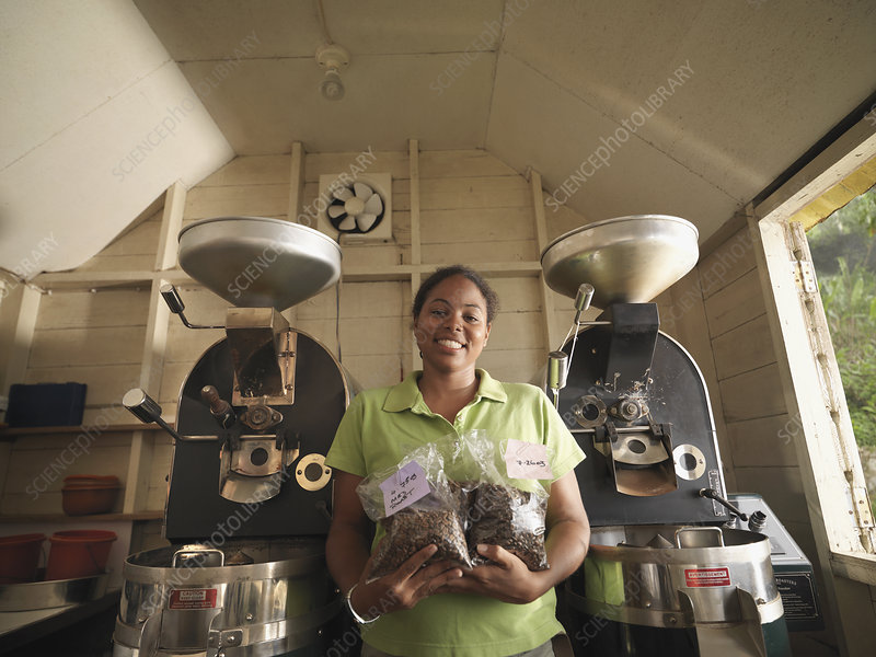 Female Coffee Worker With Packaged Beans