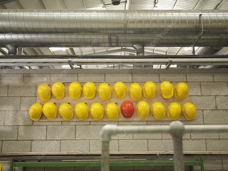 Rows Of Yellow And Red Hard Hats