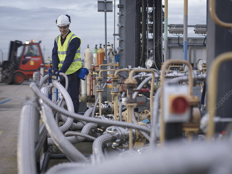 Port Worker Inspecting Pipe Work