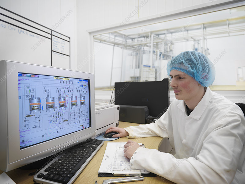 Food Worker With Data On Computer