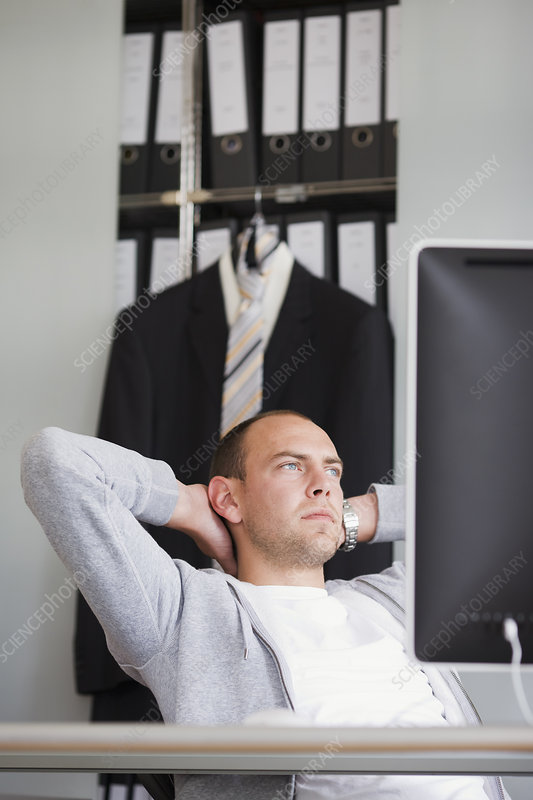 man sitting at desk thinking
