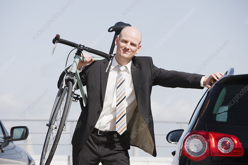 man carrying bike