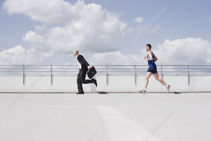 business man running from jogger
