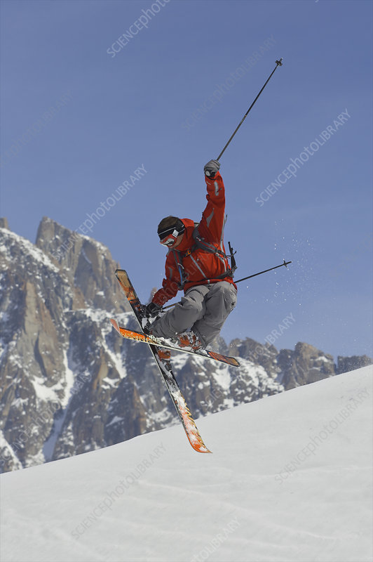 Freeride skier jumping into the air