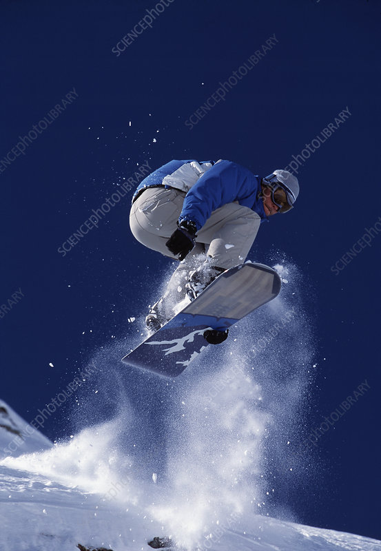 Snowboarder jumping into the air