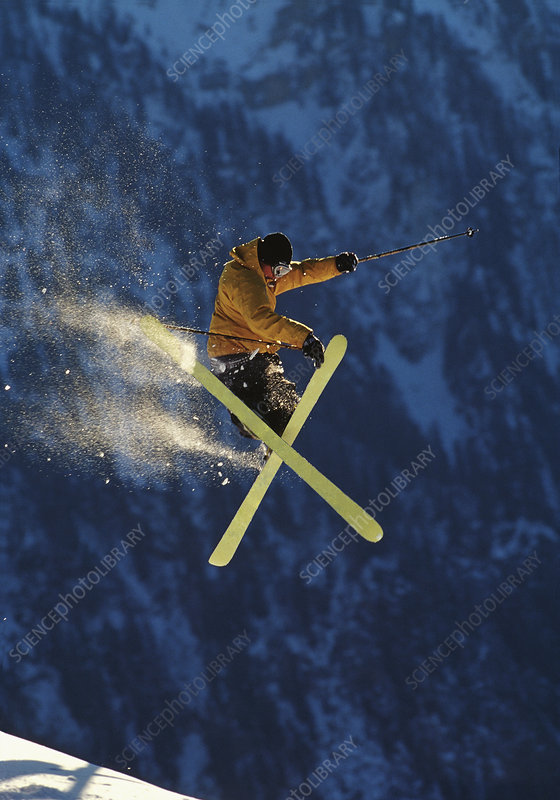 Skier jumping performing a trick