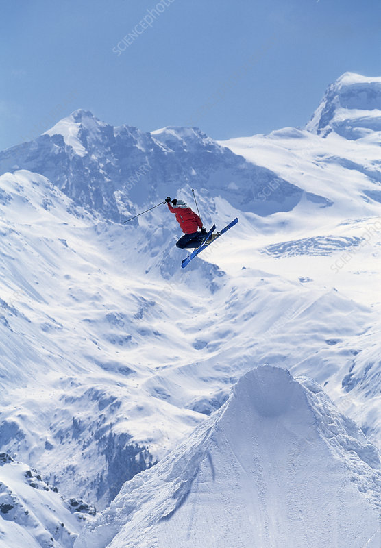 Freestyle skier jumping into the air